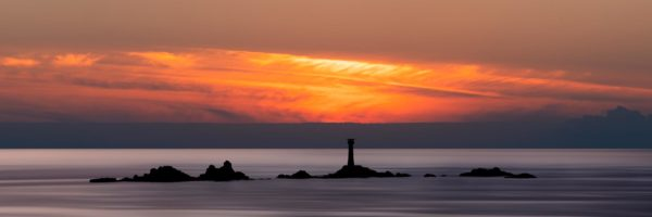 Panorama of Land's End and Longships lighthouse along the south west coastal path in Cornwall