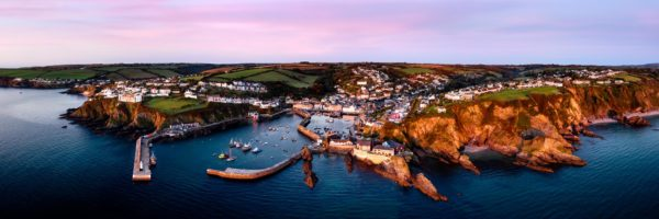 Aerial Panorama of Mevagissey harbour fishing village in Cornwall on the southwest coast path