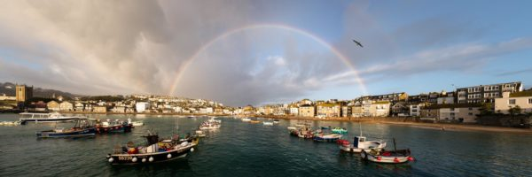 St Ives harbour and fishing boats with a rainbow on the Cornwall coast