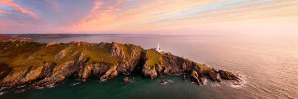 Panorama of start point lighthouse at sunrise along the south west coast path in Devon