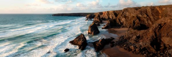 Panorama of bedruthan steps beach at sunset in Cornwall along the south west coast path